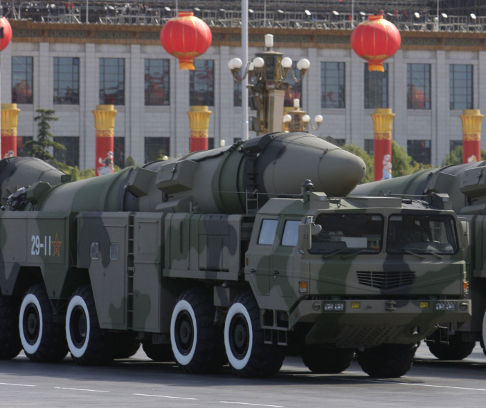 """Chinese military vehicles carry the Dong Feng 21D """"carrier killer"""" missile during a military parade in Beijing on Oct. 1, 2009. The missile under development is designed to be launched from land to hit a carrier hundreds of miles away. """"Though still unproven (and some analysts say overrated) no other country has such a weapon,"""" reports The Associated Press."""