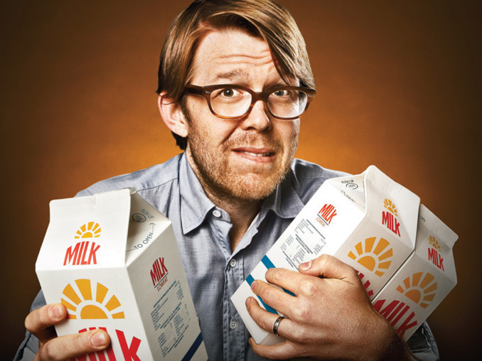 In one piece from the edgy campaign, a henpecked husband cowers with cartons of milk in his arms.