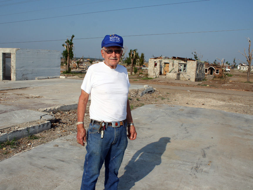 Dude Pendergraft, 80, owner of Dude's Daylight Donuts in Joplin, stands on the concrete slab where his shop used to be. After the tornado destroyed it, he's rebuilding nearby.