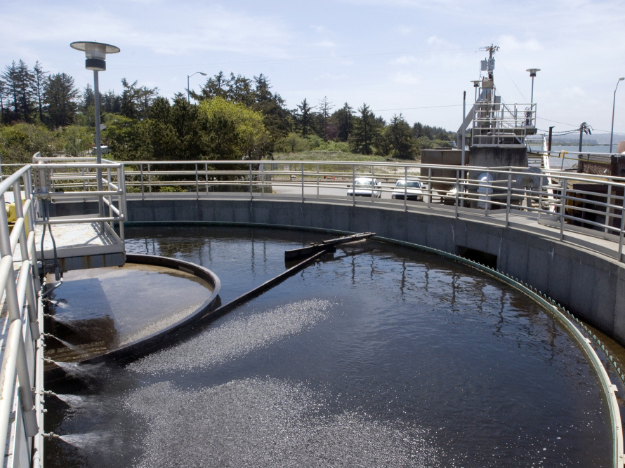 """A boom sweeps around a tank at a sewage treatment plant in Coos Bay, Ore. Even though sewage water can be treated and cleaned, psychologists say getting the """"cognitive sewage"""" out of the water is much more difficult."""