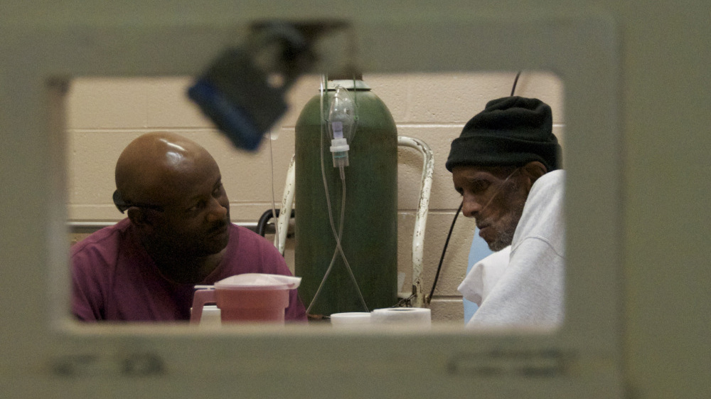 A caretaker and his patient in the documentary Serving Life.