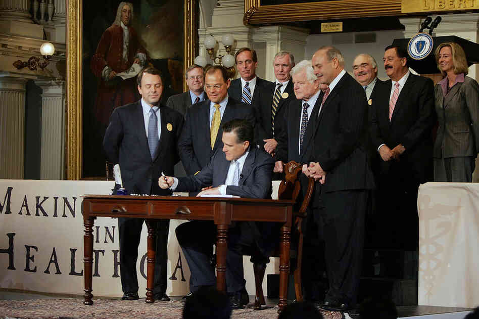Gov. Romney signs into law his landmark health care overhaul bill during a ceremony in 2006.