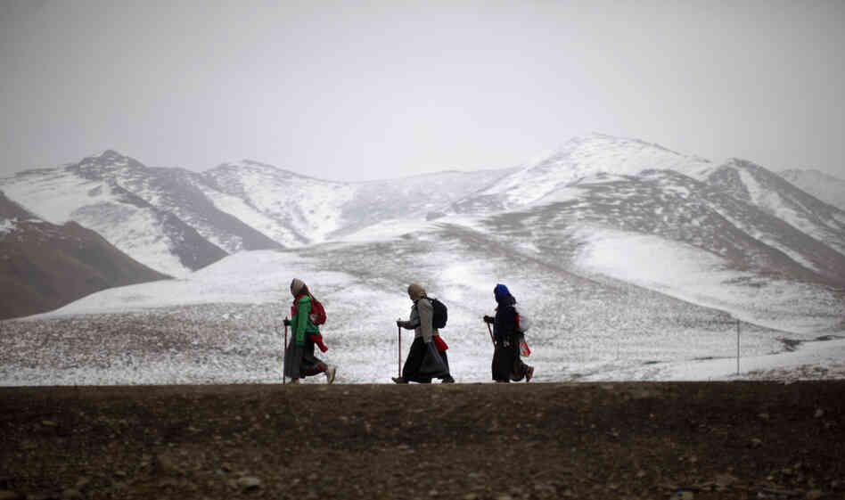 walk on a road during Tibetan New Year in Langmusixiang, Sichuan ...