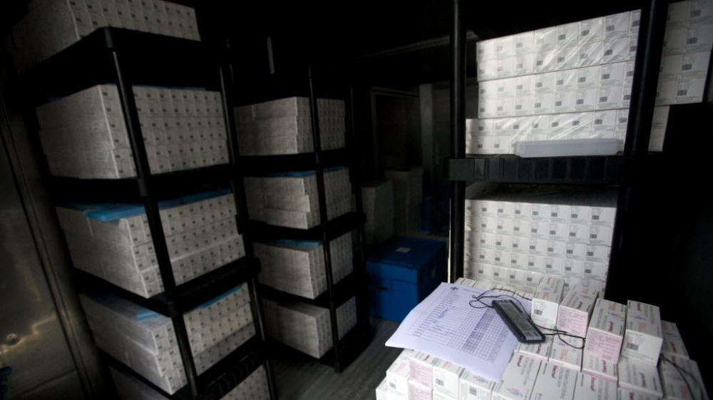 Thousands of doses of cholera vaccine sit in a refrigerated trailer in a United Nations compound in Saint-Marc, Haiti. Vaccination was supposed to begin last week, but bureaucratic problems have delayed the start. April is the beginning of Haiti's rainy season, which will likely intensify Haiti's cholera outbreak.