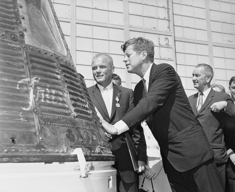 Astronaut John Glenn, left, and President John F. Kennedy, center, inspect the Friendship 7 Mercury capsule on Feb. 23, 1962, which Glenn rode in orbit. At right is Vice President Lyndon B. Johnson.