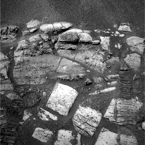 """Opportunity captures the layered rocks of the """"El Capitan"""" area near the rover's landing site at Meridiani Planum, 2004. (Visible on two of the rocks are the holes drilled by the rover, which provided scientists with a window to this part of the red planet's water-soaked past.)"""