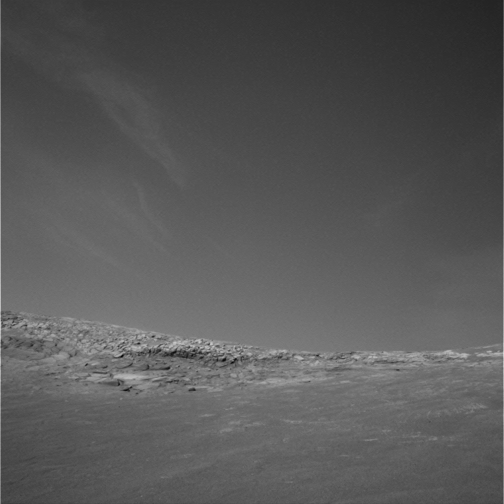 Winter clouds — again, almost Earthly — drift across the skies at Endurance Crater, 2004.