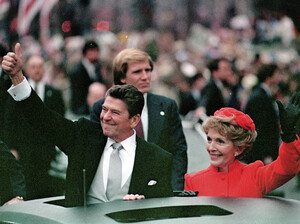 """President Ronald Reagan and his wife, Nancy Reagan, in the inaugural parade in Washington, D.C., in January 1981. In his speech after being sworn in, Reagan called government """"the problem."""""""