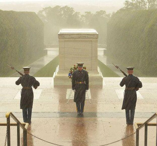 Soldiers of the 3rd Inf Reg. continue to stand guard at the Tomb of the Unknown Soldier, despite the worsening weather conditions surrounding Hurricane Sandy.