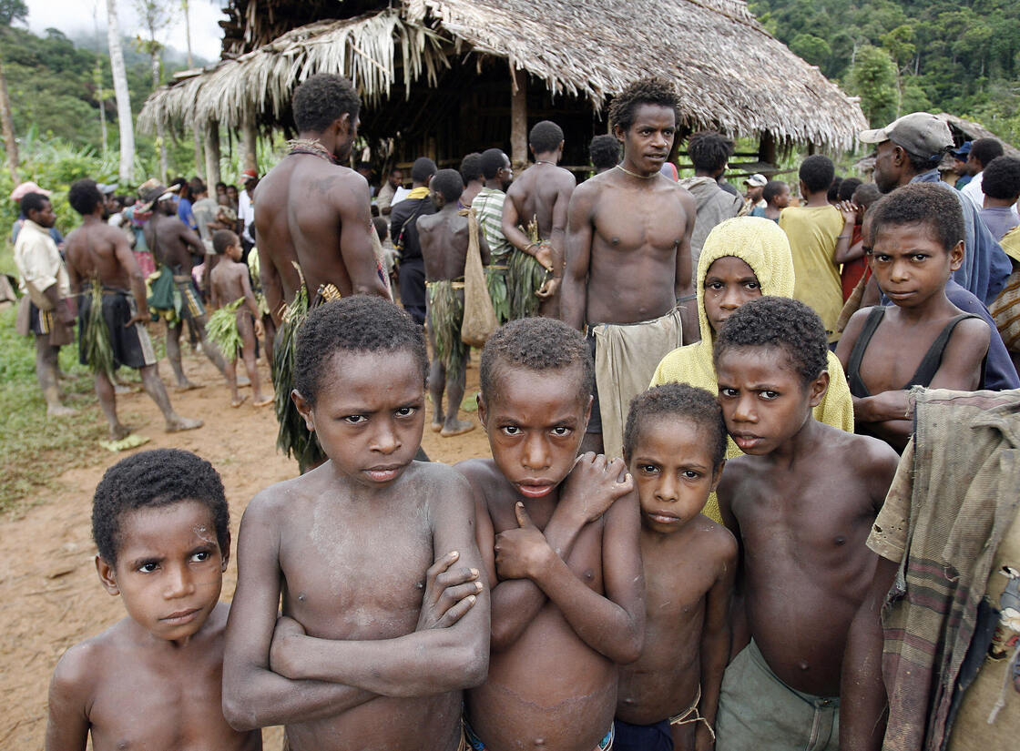 Chances are they already speak more languages than you: children from Papua New Guinea's Andai tribe of hunter-gatherers wait for their parents to vote in the village of Kaiam. Over 800 languages are spoken in PNG, a country of about six million people.