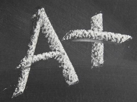 Big fat A+ written in chalk on a blackboard.