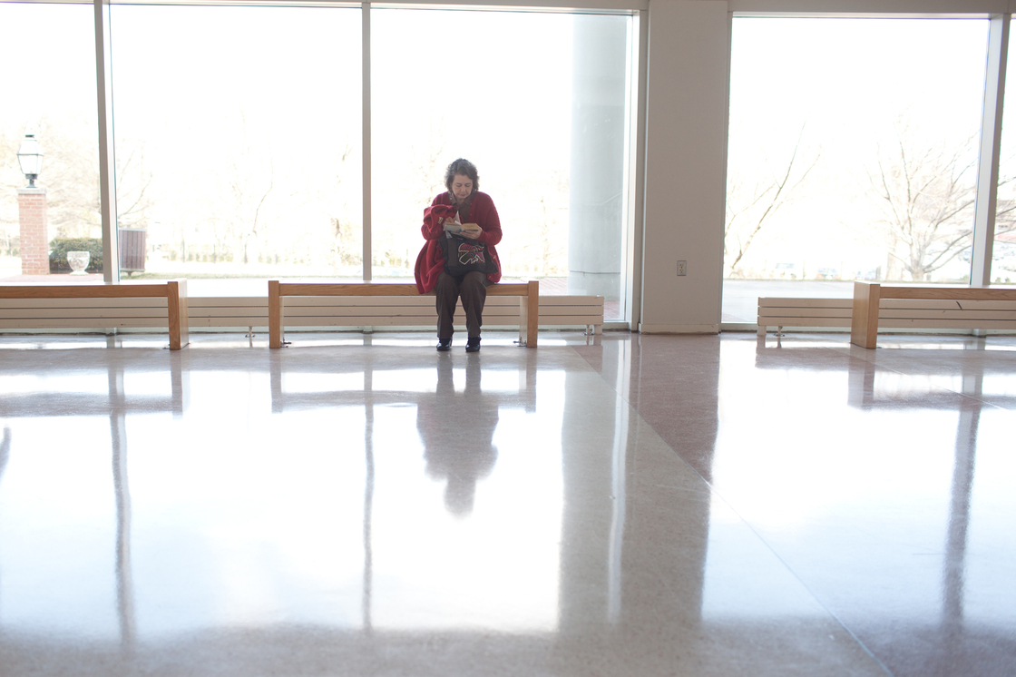 Eden's mother waits outside of the courtroom.