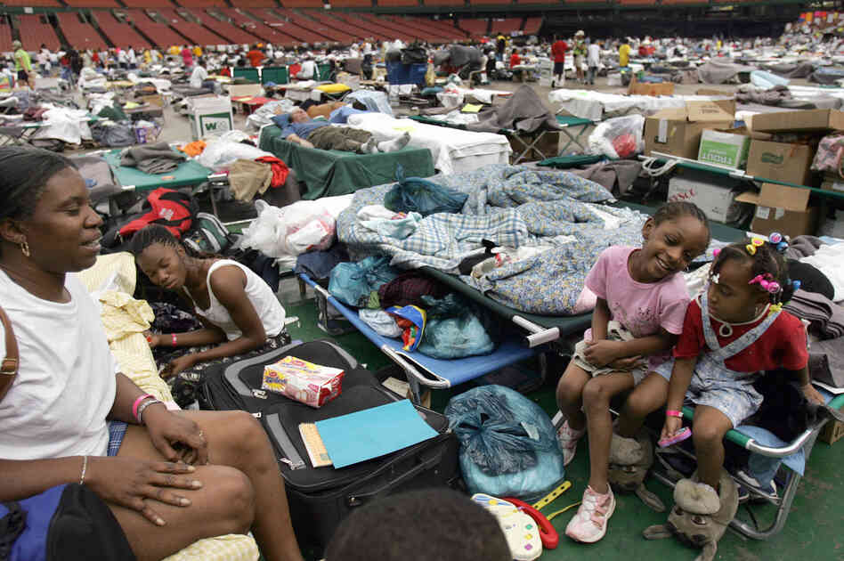 Hurricane Katrina evacuees sit on makeshift beds on the Astrodome's floor on Sept. 9, 2005. The stadium sheltered thousands of people fleeing from the devastation in New Orleans.
