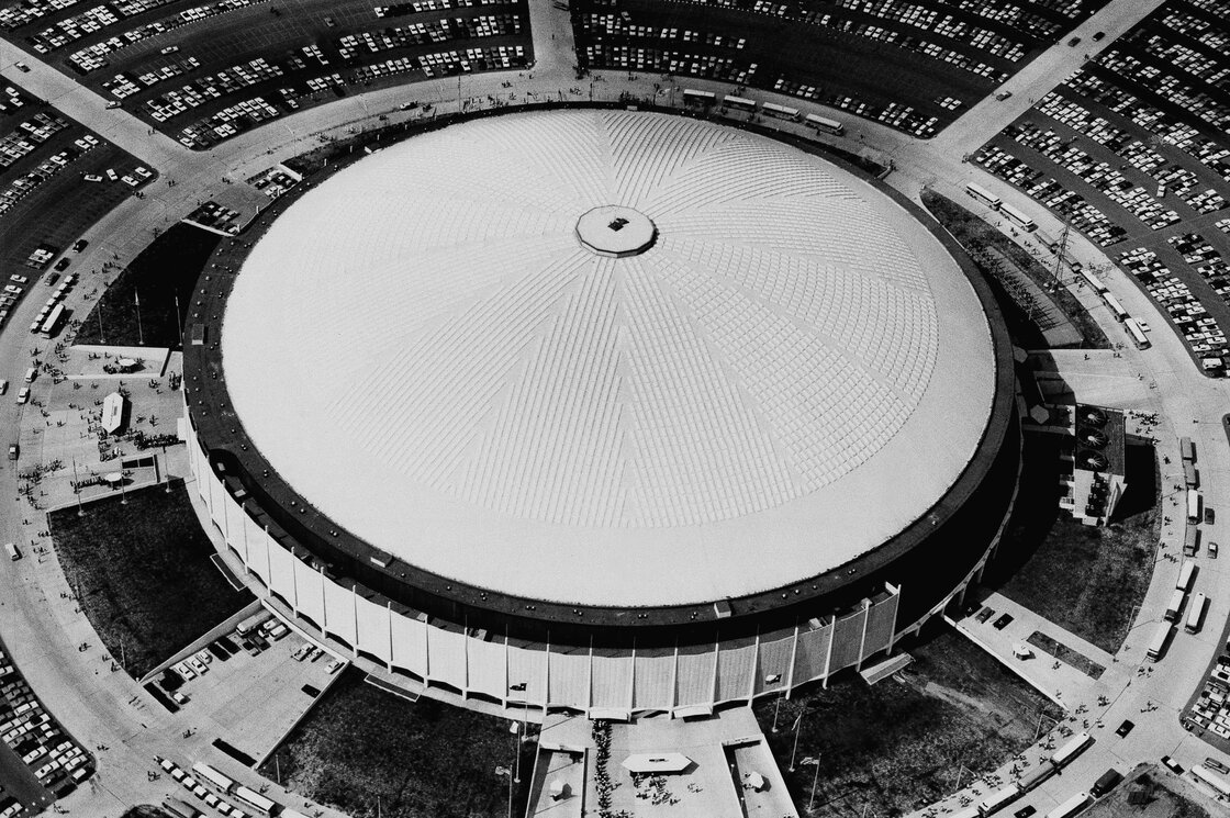 "View of the Astrodome from above in 1968. Earlier this year, The New York Times wrote that the Astrodome ""gave us domed, all-purpose stadiums and artificial turf and expansive scoreboards."" The dome went on to host a variety of sports events, large concerts and a political convention."