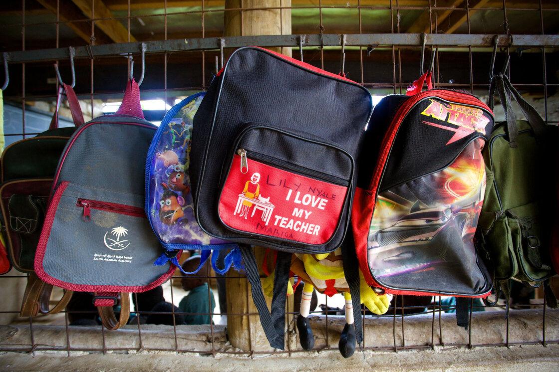 Backpacks hang outside a Bridge classroom in Kiembeni, near the city of Mombasa.
