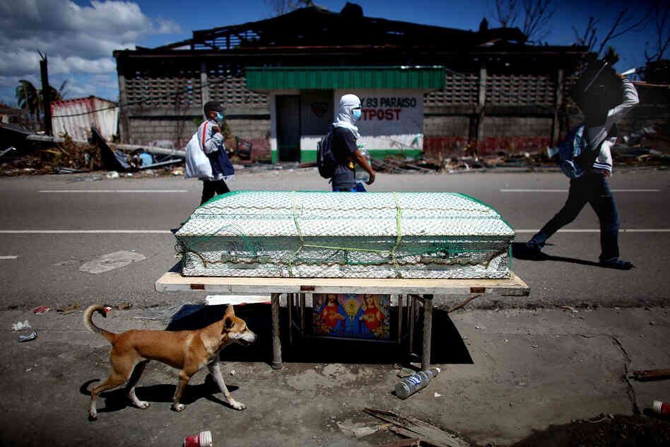 A casket sits at the side of the road waiting for removal by health workers.