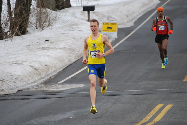 Eric Ashe takes the lead in the Jones Group 10 Mile USATF Championship on Feb. 23.