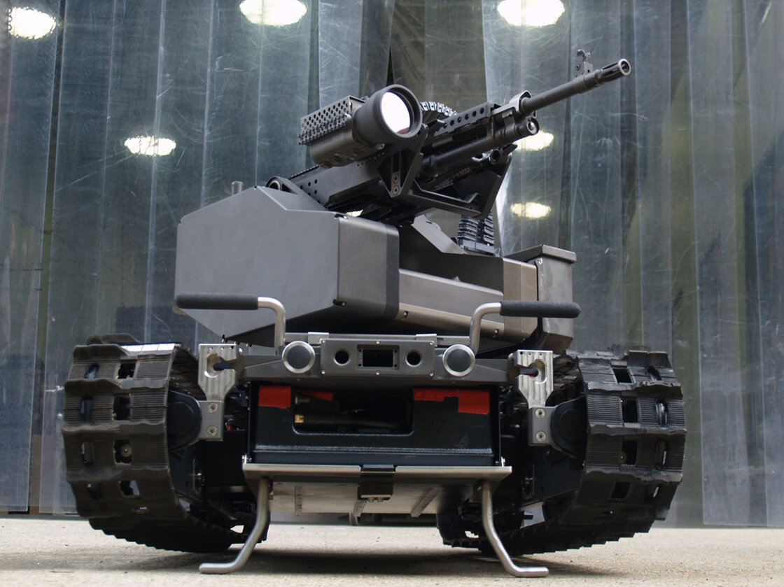 The TALON MAARS (Modular Advanced Armed Robotic System) robot can be transformed from an weaponized robot to one with an arm and gripper by changing out its modules. (PRNewsFoto/Foster-Miller, Inc.)