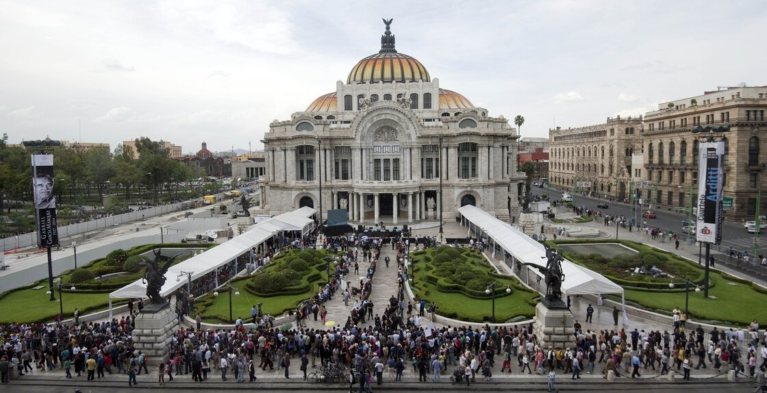 People wait outside the Fine Arts Palace in Mexico City on Monday to pay tribute to Gabriel Garcia Marquez.