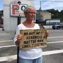 Susan St. Amour panhandles on a median in Portland, Maine. The city tried to ban loitering on medians last year, but a judge found the law unconstitutional.