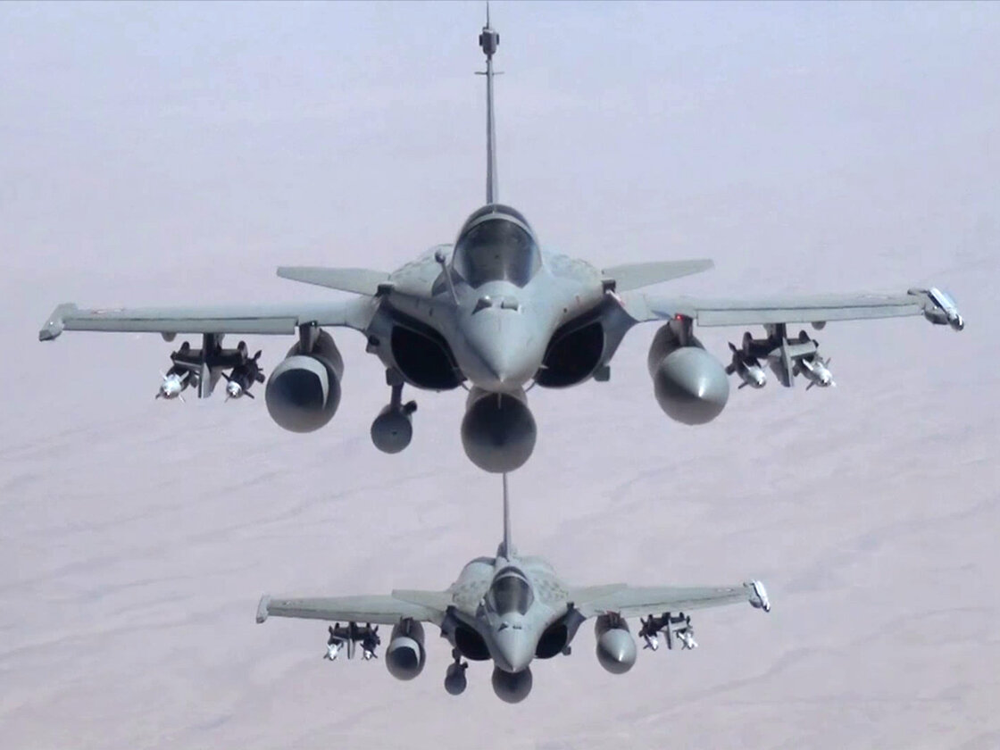 A remote camera screen grab provided by the French Army shows two Rafale jet fighters flying over Iraq on September 19. French President Francois Hollande announced that the fighters had carried out their first airstrikes in northern Iraq.