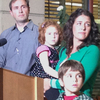 Sofia Jarvis, seen here with her family at a press conference in February, is one of several dozen children in California who have been diagnosed with a rare paralytic syndrome. It has left her left arm paralyzed.