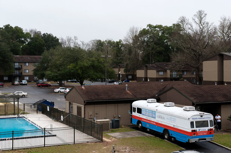 "Dr. Nancy Hardt's free ""clinic on wheels,"" parked in December at an apartment complex in Gainesville, Fla., gets about 5,000 visits from patients each year."