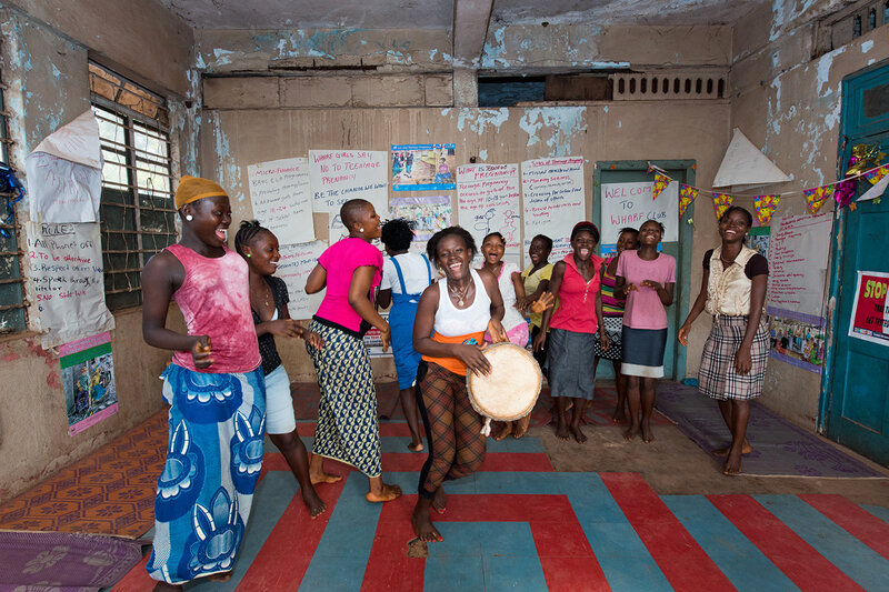 School may not be in session, but there are special clubs for girls to talk about their radio lessons and just have fun hanging out.