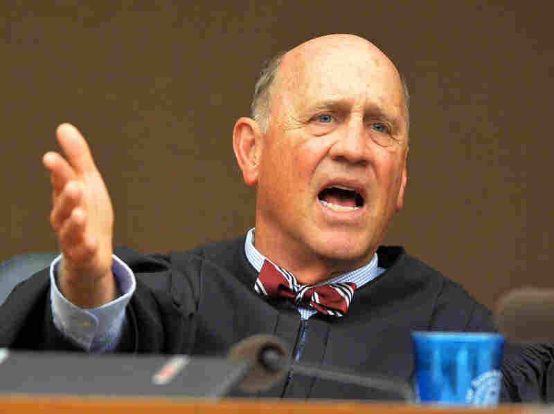 Fulton County Superior Court Judge Jerry Baxter makes a ruling on allowing evidence in the test-cheating trial at the Fulton County Superior Court in Atlanta in October 2014.