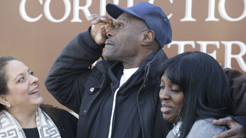 Stanley Wrice pauses in December 2013 as he speaks to the media with his lawyer, Heidi Linn Lambros (left), and his daughter, Gail Lewis, while leaving Pontiac Correctional Center in Pontiac, Ill. Wrice was released after serving more than 30 years. He claimed for decades that Chicago police detectives under the command of then-Lt. Jon Burge beat and coerced him into confessing to rape.