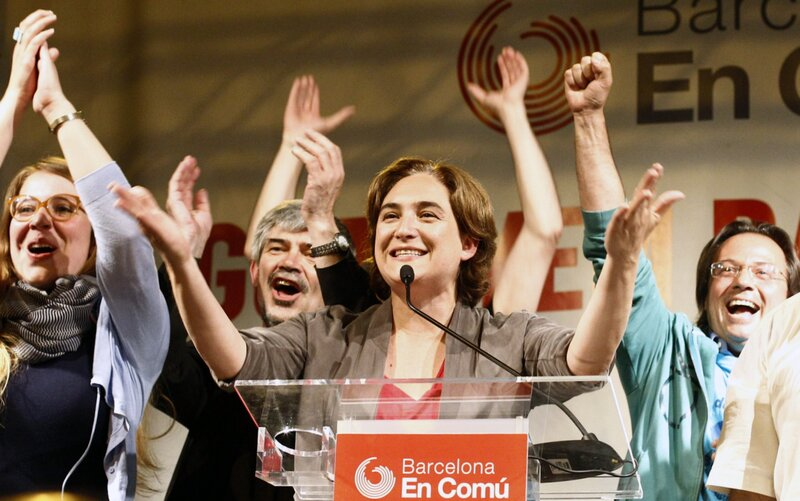 Ada Colau (center), leader of the Barcelona en Comú party, celebrates in Barcelona during a press conference following the results in Spain's municipal and regional elections on May 24. She is the first member of Spain's indignados protest movement to win public office.