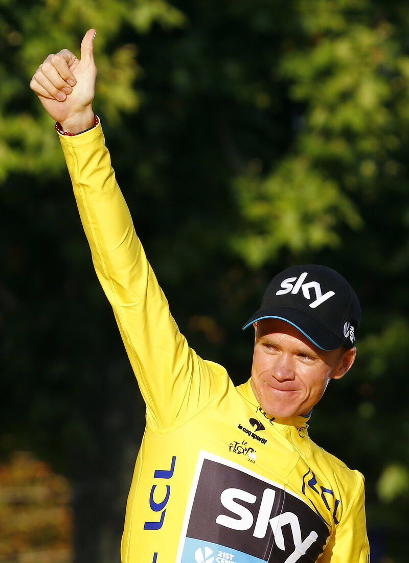 Team Sky rider Chris Froome of Britain, with the race leader's yellow jersey, celebrates his overall victory on the podium after the 109.5-km (68 mile) final 21st stage of the 102nd Tour de France.
