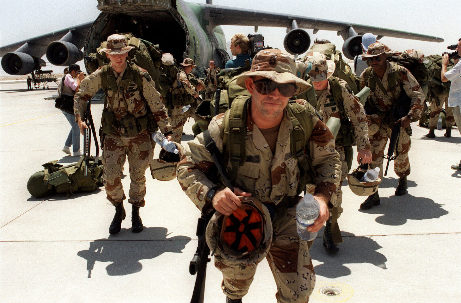 U.S. Marines arrive at Saudi Arabia's Dhahran Air Base on Aug. 21, 1990. The U.S. began a buildup in the region just days after Iraq invaded Kuwait on Aug. 2 of that year. The U.S. military has been active in Iraq virtually nonstop for the past quarter-century.