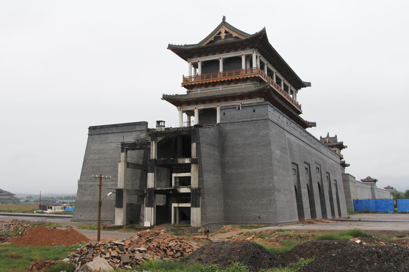 "Luliang's planned ""Liquor City"" has run short of funding. Workers have yet to finish this replica of the Great Wall, which is supposed to surround a massive factory complex producing baijiu, an often expensive Chinese hard liquor."