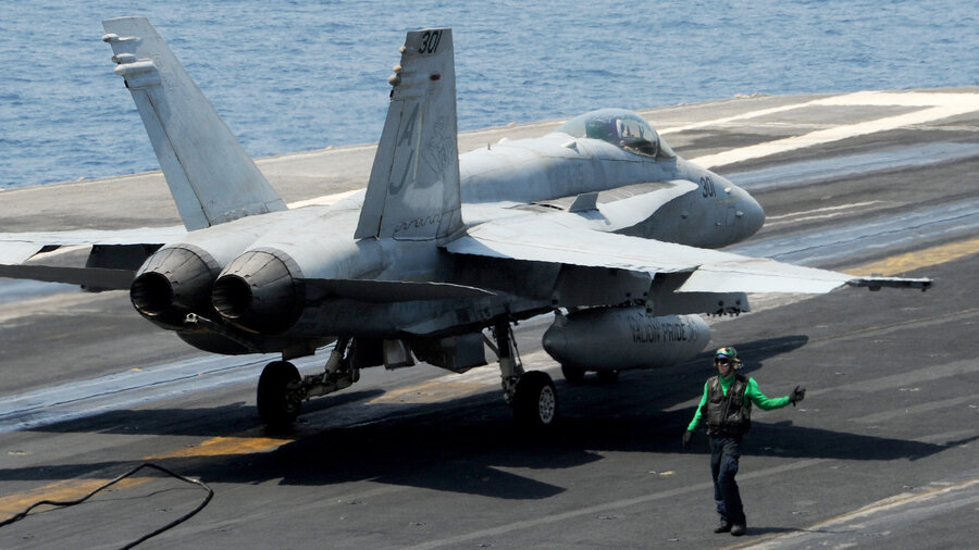 A Marines F/A-18 fighter jet similar to this one has crashed near Cambridge, England. This file photo from the U.S. Navy shows an F/A-18C Hornet on the flight deck of the aircraft carrier USS George H.W. Bush.