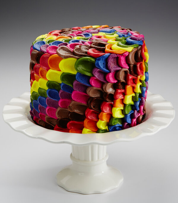 This multi-colored cake's icing is made from red cabbage juice, turmeric, annatto, beet juice, and caramel color.