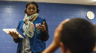 Yolanda Roberson, who directs the Empowerment program, teaches a class at a Boys and Girls Club in the Bronx. The classes are funded by the state of New York. (Robert Stolarik for NPR)