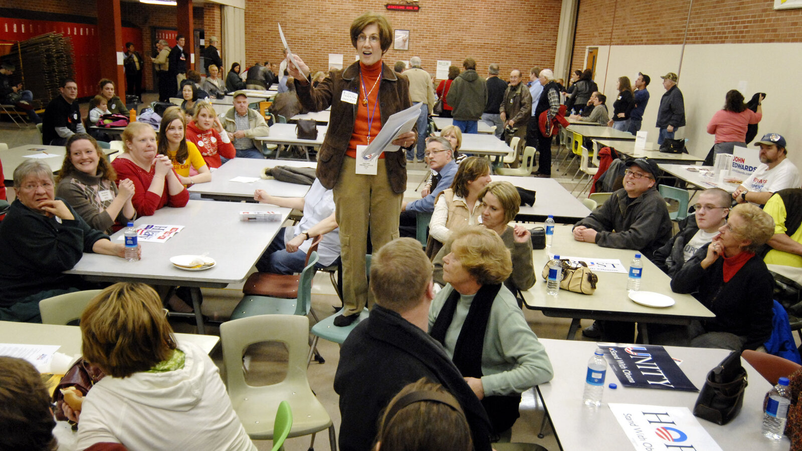Precinct Chairwoman Judy Wittkop explains the rules during a 2008 Democratic caucus in Le Mars, Iowa.