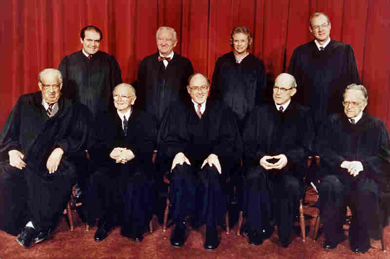 Members of the U.S. Supreme Court pose for a formal portrait in Washington in 1988. (From left, front row) Associate Justices Thurgood Marshall; William Brennan, Jr.; Chief Justice William Rehnquist; Byron White; and Harry Blackmun. (Back row, from left) Antonin Scalia; John Paul Stevens; Sandra Day O'Connor and Anthony M. Kennedy.