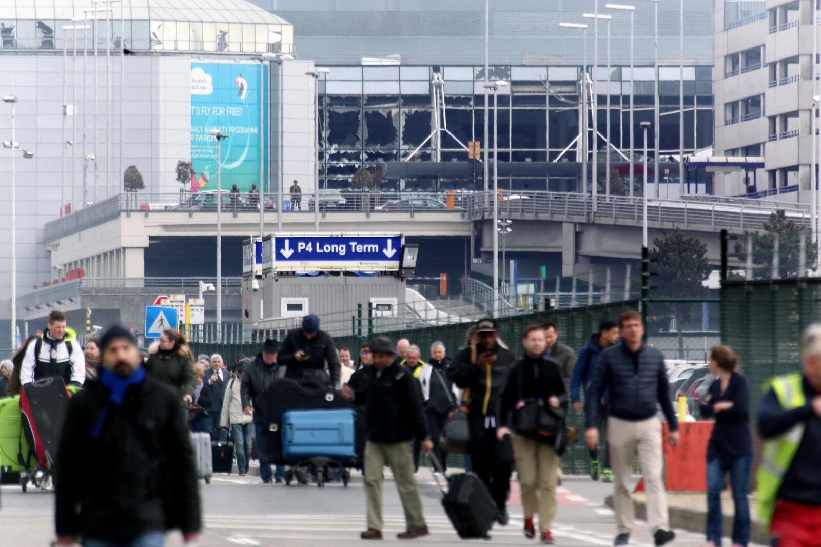 People are evacuated from the Zaventem international airport after a terrorist bombing earlier today in Brussels.