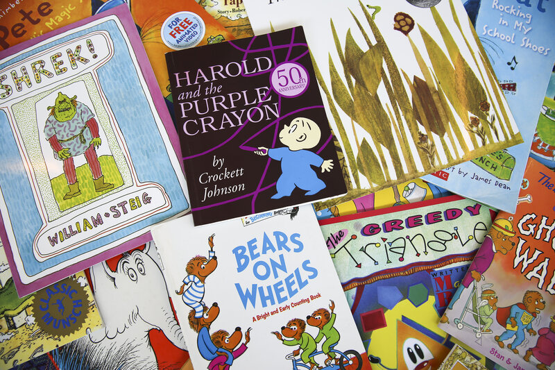 Children's books scattered on the floor