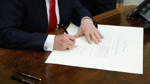 President Trump signs a confirmation for James Mattis to be defense secretary, Friday in the Oval Office.