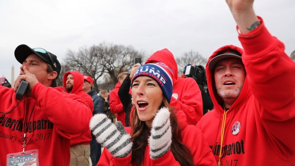 Supporters react on the National Mall to the inauguration of Donald Trump on January 20, 2017 in Washington, DC.