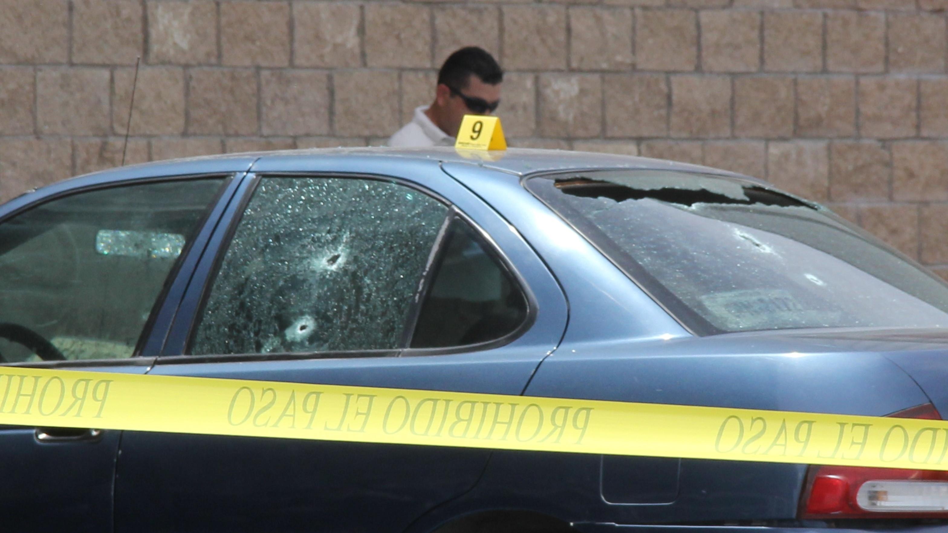 Police investigators work on the crime scene where Mexican journalist Maximino Rodriguez Palacios was killed by gunmen April 14 in La Paz, Baja California Sur, Mexico.