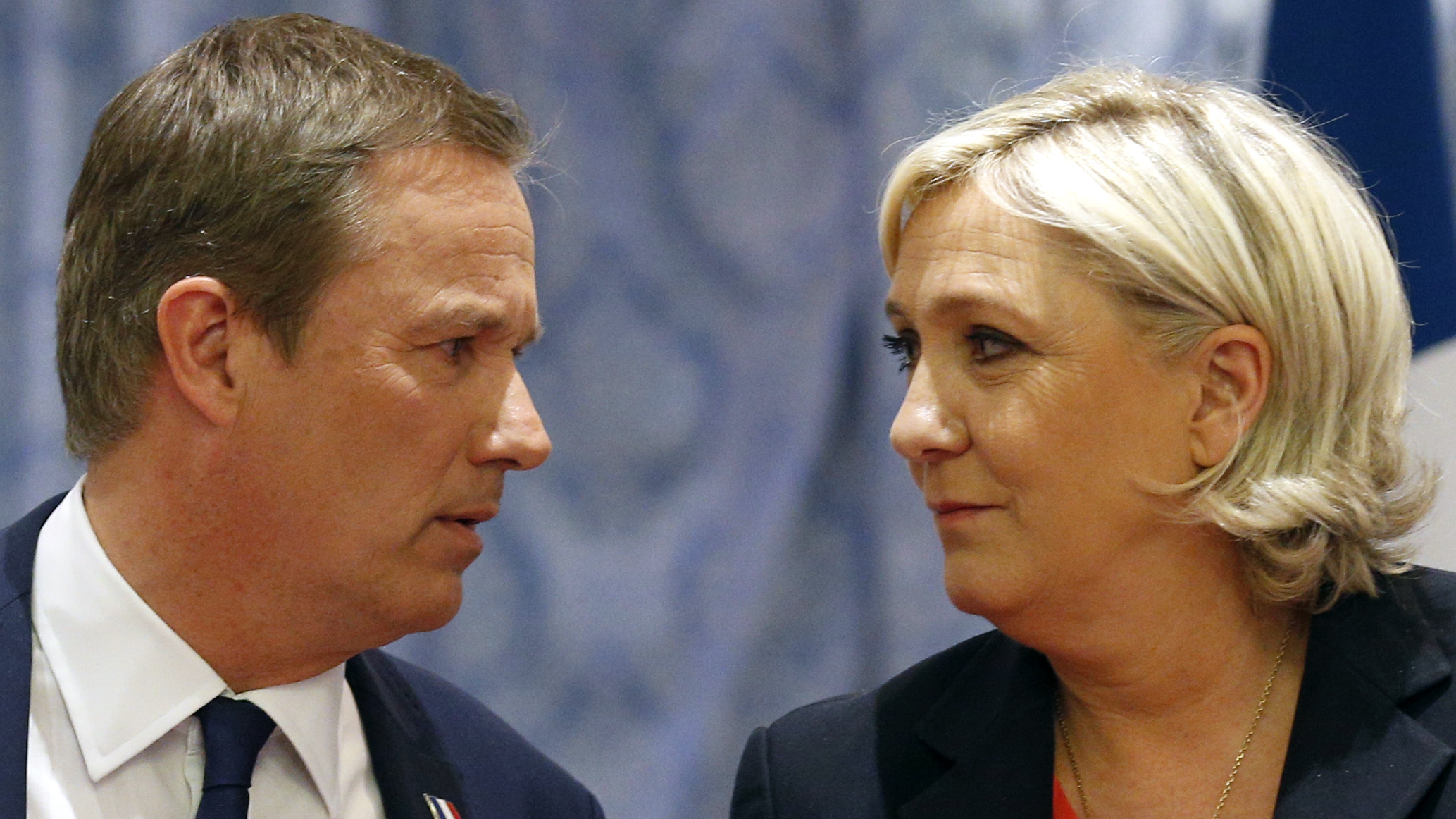 Nicolas Dupont-Aignan (L) and Marine Le Pen, at a joint press conference in Paris, on April 29, 2017, where Le Pen declared she would appoint Dupont-Aignan prime minister if elected. / AFP PHOTO / GEOFFROY VAN DER HASSELT (Photo credit should read GEOFFROY VAN DER HASSELT/AFP/Getty Images)