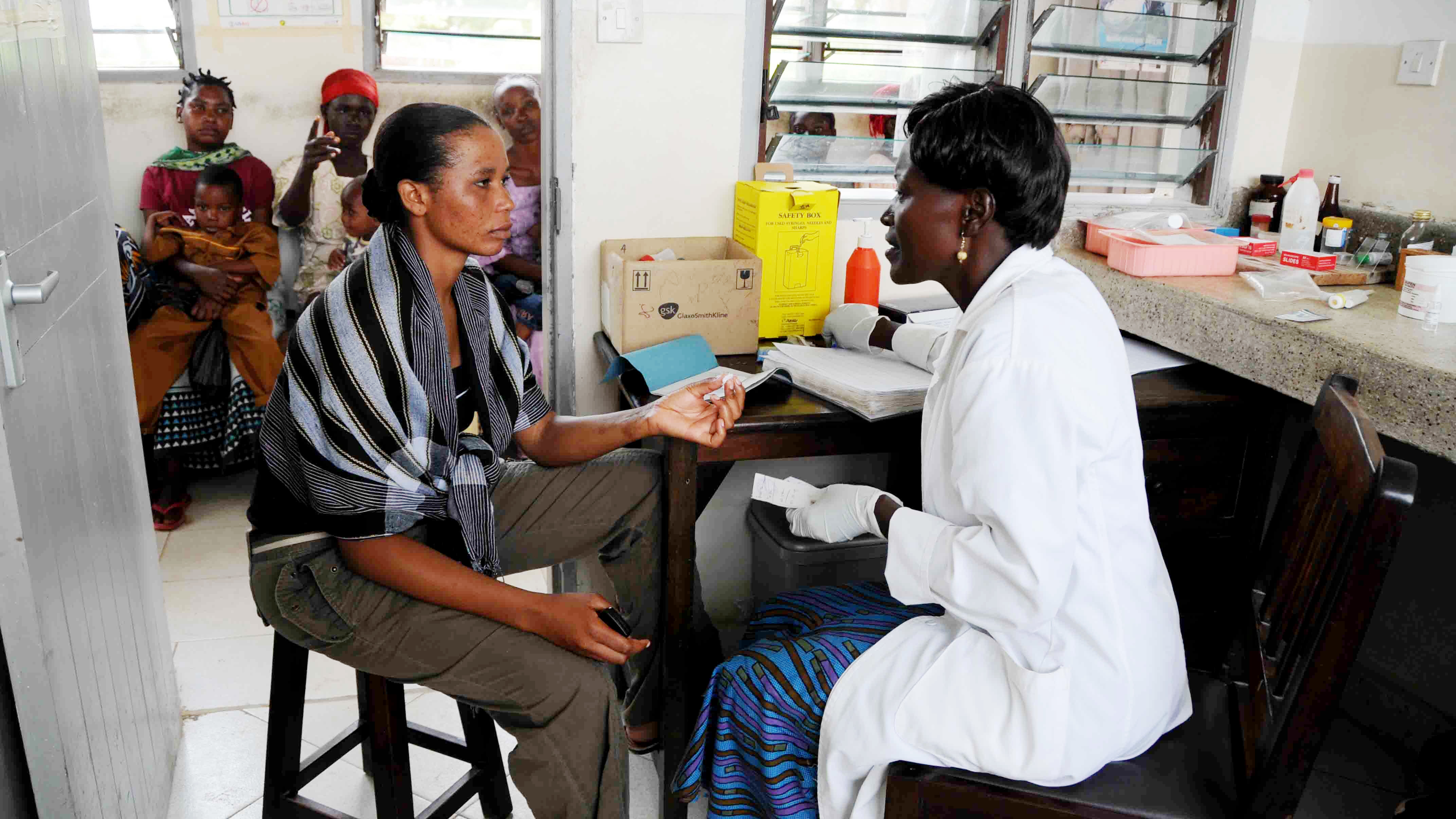 """A patient is tested for malaria at a clinic in Kenya. U.S. funding for anti-malaria efforts, HIV prevention and other programs abroad could be affected by the newly expanded """"Mexico City"""" policy."""