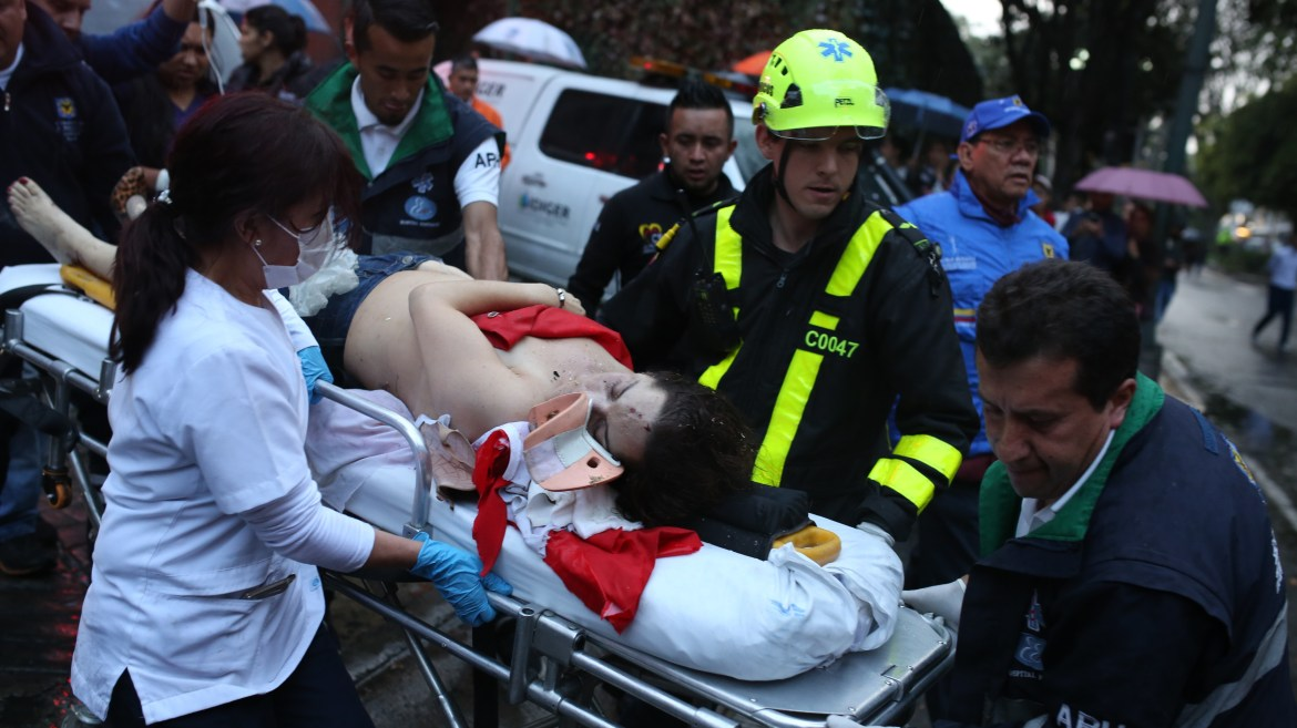 A woman is evacuated on a gurney after an explosion at the Andino shopping center in Bogota, Colombia on Saturday.