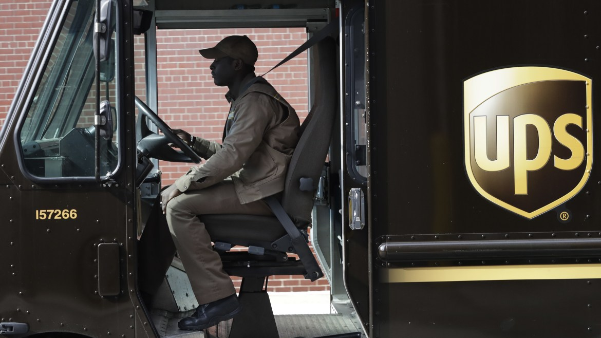 A UPS driver takes his truck on a delivery route last month in New York.