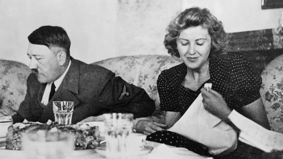 Berlin, Germany: A candid photograph of Eva Braun with Adolf Hitler at the dining table. A new book explores the lives of six women through food, and Hitler