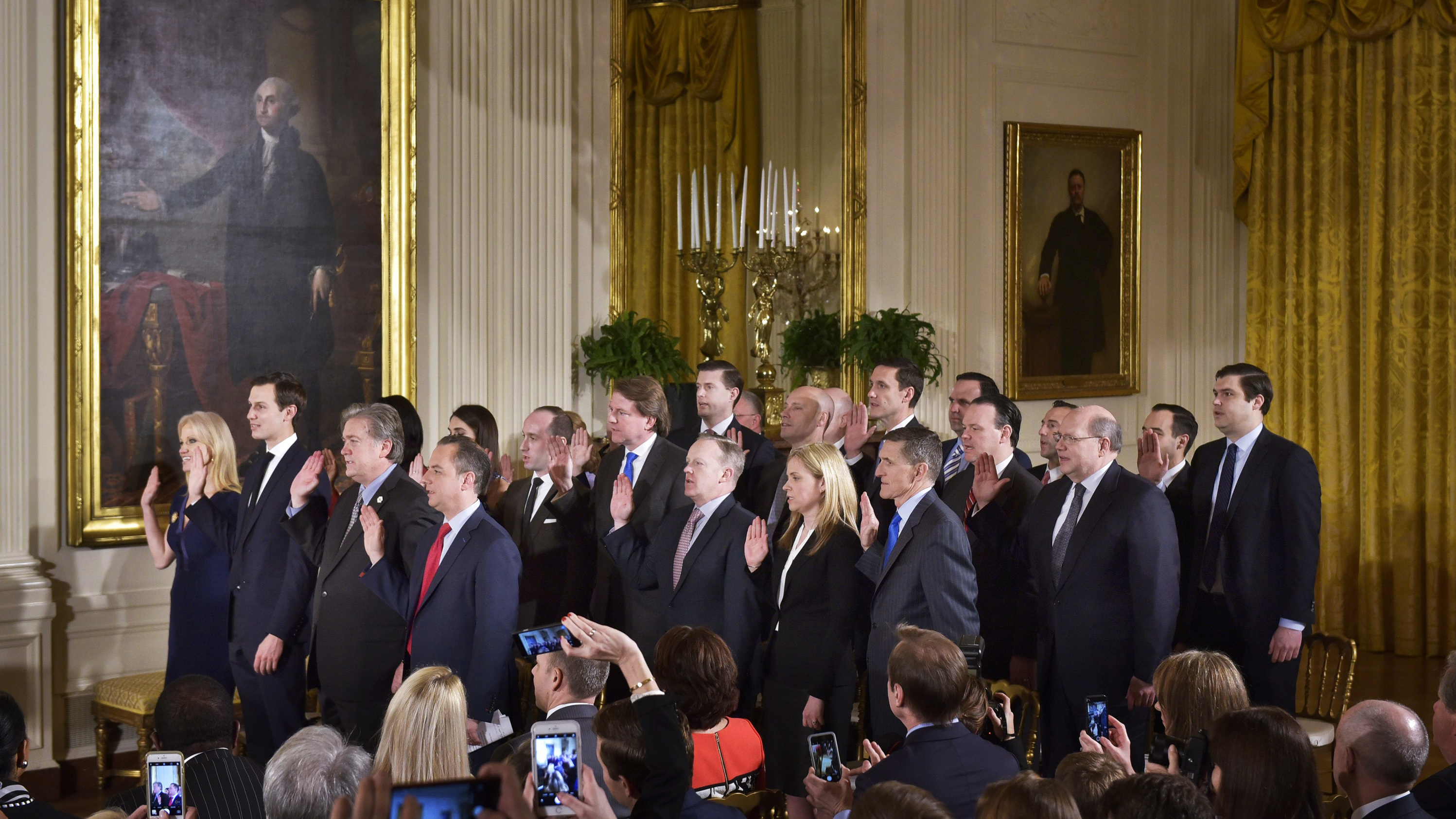 The White House senior staff is sworn in at the White House in January. Twenty-two members of the staff will make $179,700 this year and 18 more earn $165,000 a year, making the Trump administration